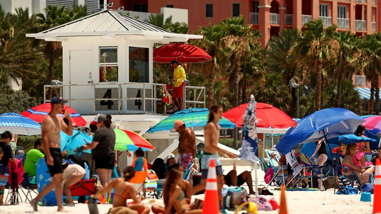 People visit Clearwater Beach in Florida after the state reopened its beaches in May