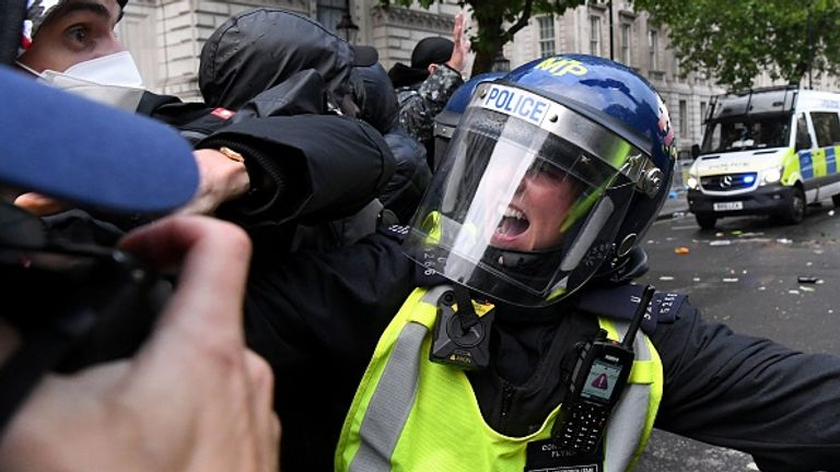 Protesters scuffled with police in riot gear near Downing Street,