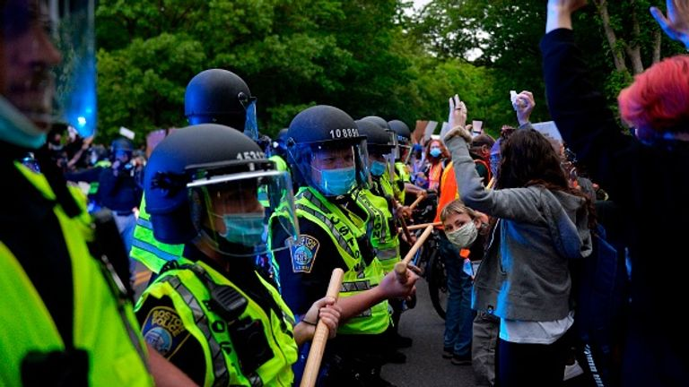 Protesters confront police at a peaceful demonstration in Boston