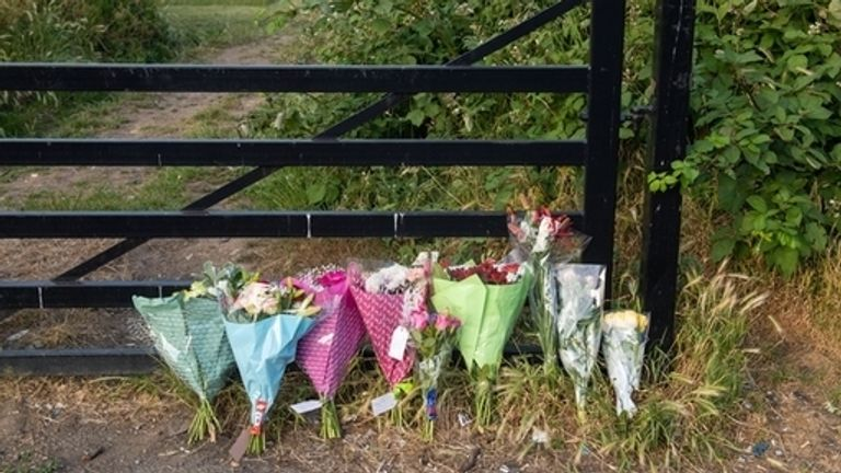 Flowers left at Fryent Country Park, where the sisters were found dead