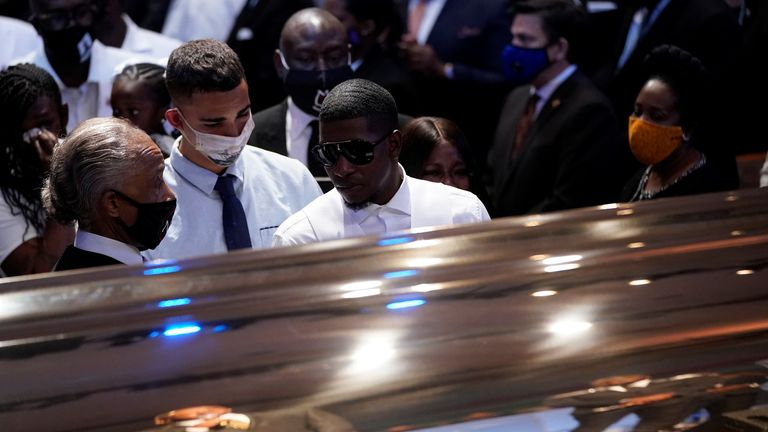 George Floyd's son Quincy Mason Floyd in front of his father's casket