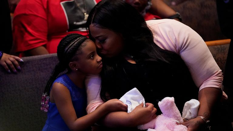 Roxie Washington, the mother of George Floyd's youngest daughter, Gianna, comforts her during his funeral