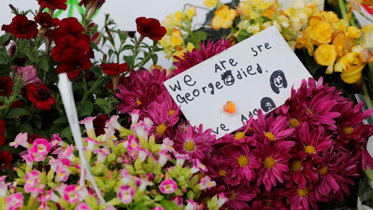 Messages and flowers have been left close to where Mr Floyd died