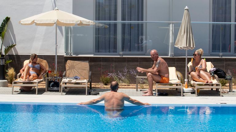 German tourists rest at the swimming pool of the RIU Concordia hotel in Palma, Mallorca, in Spain