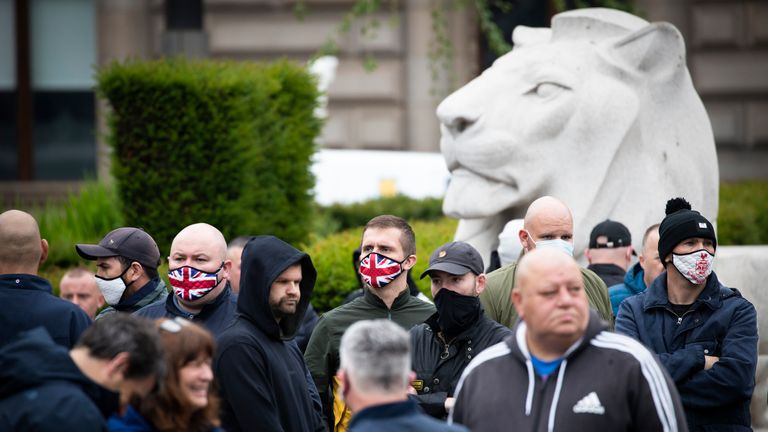 Activists gather at the cenotaph in George Square, Glasgow, to protect it from any vandalism attacks