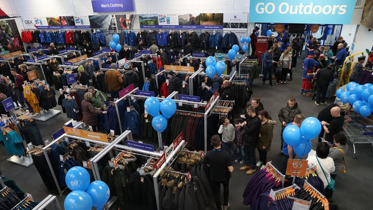 Members of the public walk into the newly opened GO Outdoors store in Nottingham