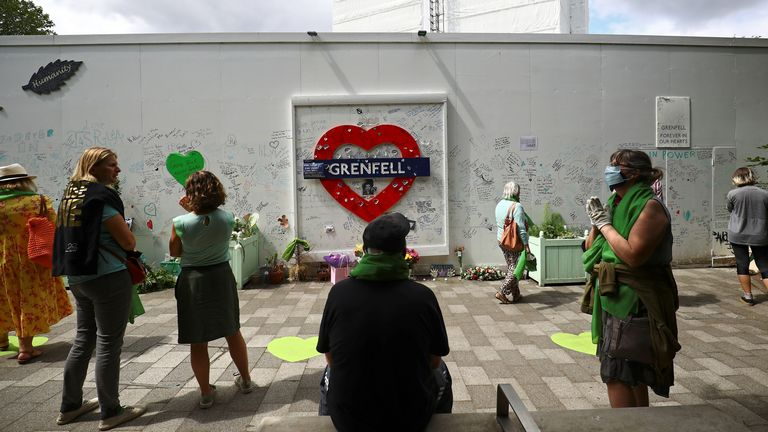 People gather during a commemoration to mark the third anniversary of the Grenfell Tower fire