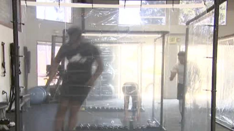 """One gym owner in Southern California found a unique solution to reopening during the pandemic: """"workout pods"""" made from pipes and shower curtains."""