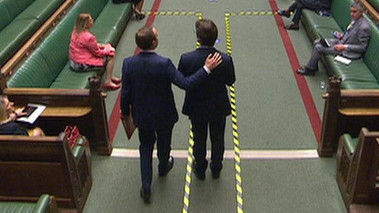 Health Secretary Matt Hancock patted the back of an MP in the Commons before finally noticing he was breaching the rules.