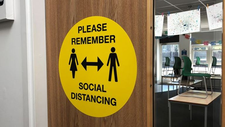 Signs are in place at Handcross Primary School to remind pupils about social distancing