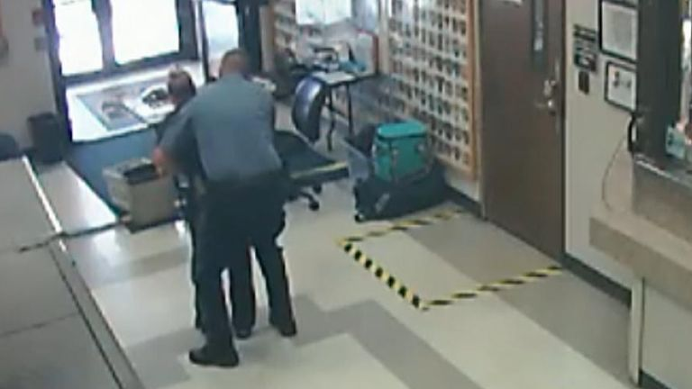 Police officer performs Heimlich manoeuvre on choking colleague