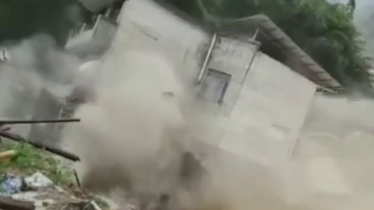House collapses into river during flooding in China
