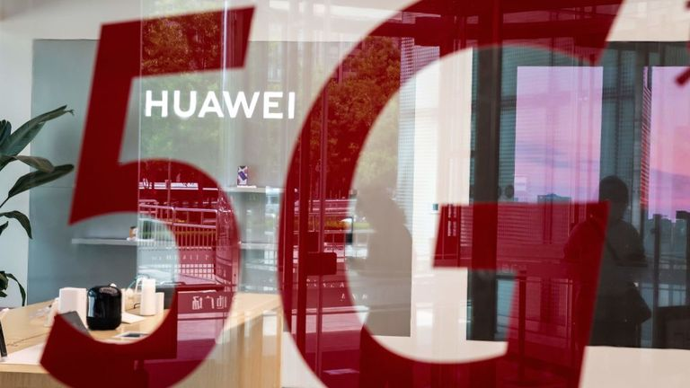 "A shop for Chinese telecom giant Huawei features a red sticker reading ""5G"" in Beijing on May 25, 2020. (Photo by NICOLAS ASFOURI / AFP) (Photo by NICOLAS ASFOURI/AFP via Getty Images)"