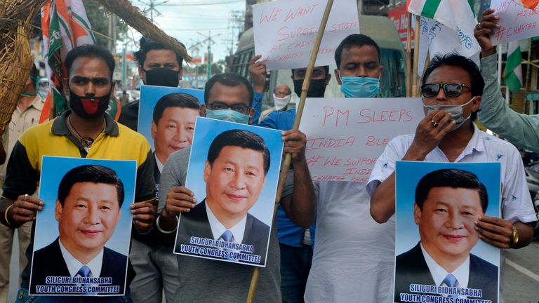 Indian activists hold posters and effigy of Chinese President Xi Jinping during an anti-China protest