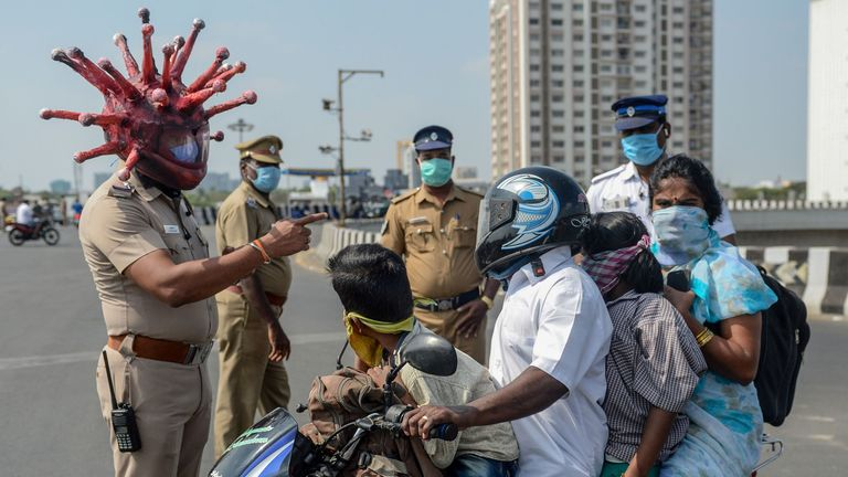 Some police in India wear coronavirus-themed helmets