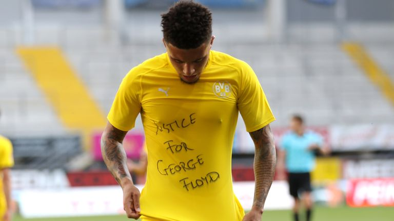 "English midfielder Jadon Sancho shows a ""Justice for George Floyd"" shirt after scoring"