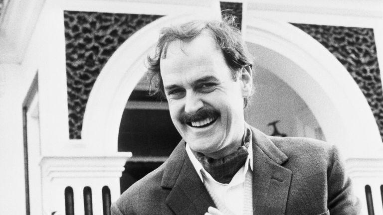 Comedian John Cleese in his role as Basil Fawlty, the manic host of Fawlty Towers