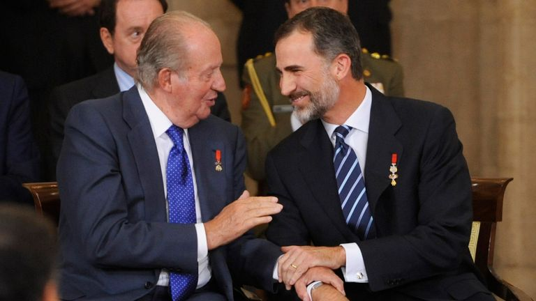 Juan Carlos (L) abdicated the throne to his son, King Felipe VI (R) in 2014