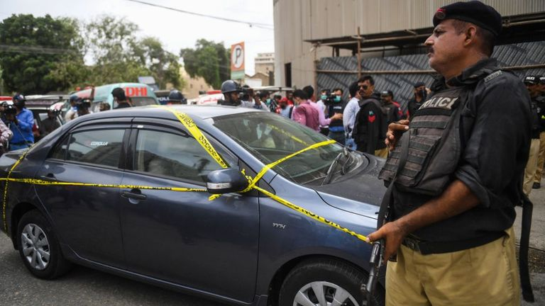 A car outside of the stock exchange was taped off by police on Sunday morning