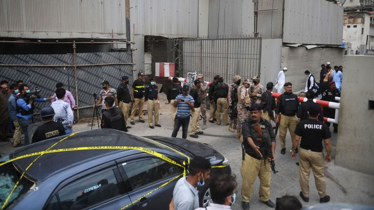 Officers are seen gathered outside of the stock exchange building on Monday morning