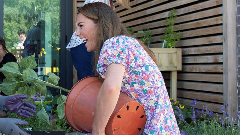The Duchess of Cambridge helps plant a tree as she visits the Nook Children's Hospice in Framingham Earl, Norfolk