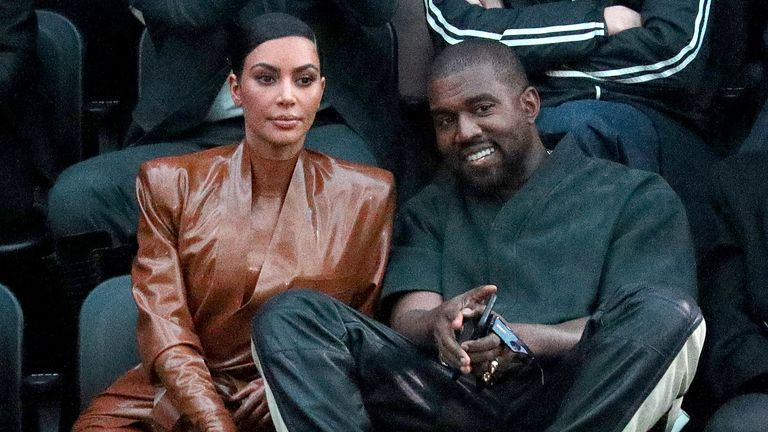 Kim Kardashian West, seen with Kanye West at Paris Fashion Week in March, has become a billionaire