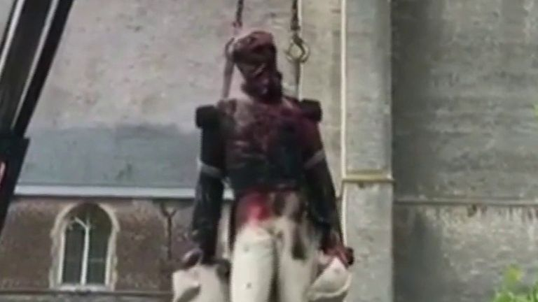 Statue of King Leopold II is removed after being vadalised in Belgium