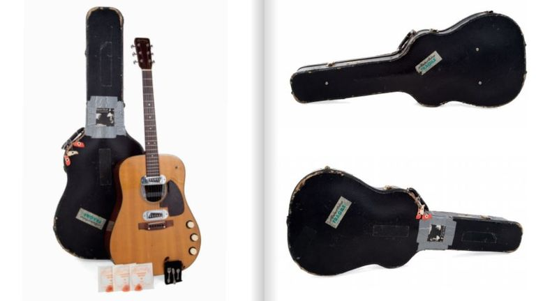 The guitar and its hardshell case were customised by Cobain