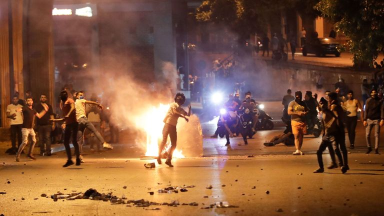 Anti-government protesters hurl rocks at Lebanese security forces in Beirut