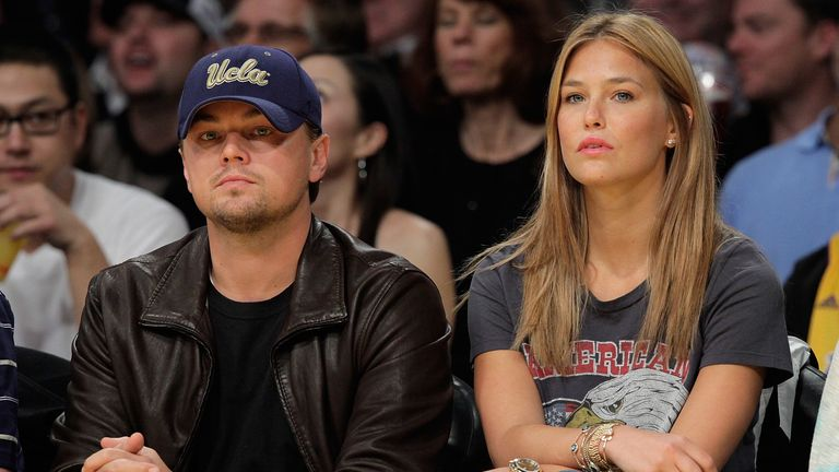 Leonardo DiCaprio (L) and Bar Refaeli (R) attend a game between the Orlando Magic and the Los Angeles Lakers at Staples Center on January on January 18, 2010 in Los Angeles, California