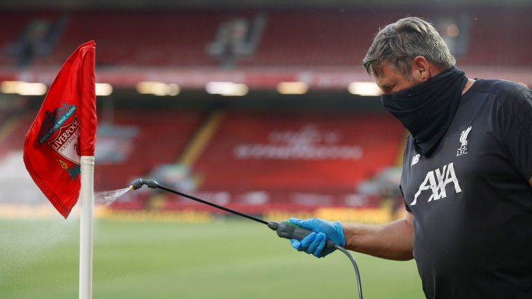 One of the corner flags at Anfield being disinfected