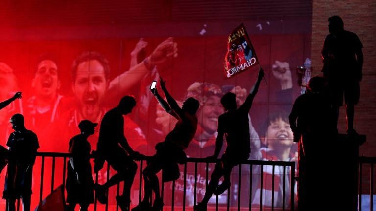 Liverpool fans celebrate outside Anfield, Liverpool