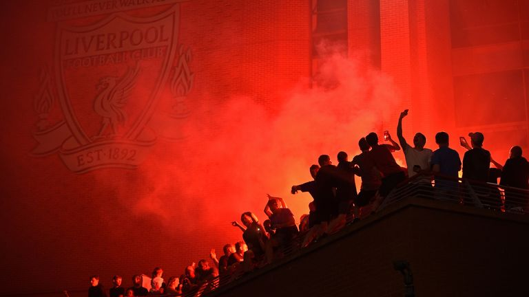 Fans celebrate at Anfield