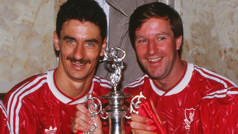 Mandatory Credit: Photo by Colorsport/Shutterstock (3153600a).Football - 1989 / 1990 First Division - Liverpool 1 Derby O (01/05/1990) Liverpool players Ian Rush and Ronnie Whelan in the Anfield dressing room with the League Championship Trophy after winning the title Liverpool 1 Derby 0.Sport