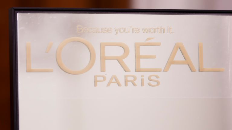 A L'Oreal sign backstage at a fashion show