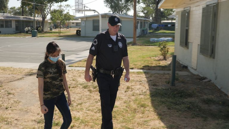 Officer Coughlin talks to a resident of Watts, south central LA