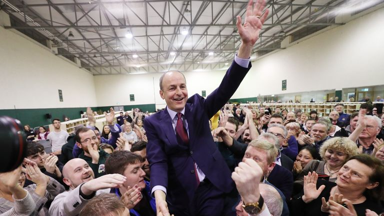 Fianna Fail leader Micheal Martin celebrates after being elected for the Cork South-Central constituency, during the Irish General Election count at the Nemo Rangers GAA Club in Cork, Ireland