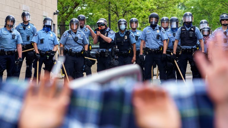 Protesters are trapped between police and other protesters who gathered in a call for justice for George Floyd following his death, outside the 3rd Police Precinct on May 27, 2020 in Minneapolis, Minnesota.