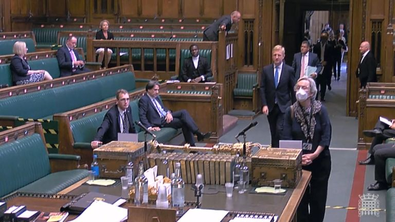 MPs queuing up to vote in the House of Commons