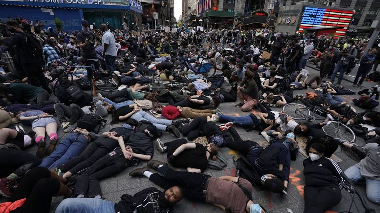 Protesters in Times Square lay on the ground with their hands behind their back in a call for justice for George Floyd