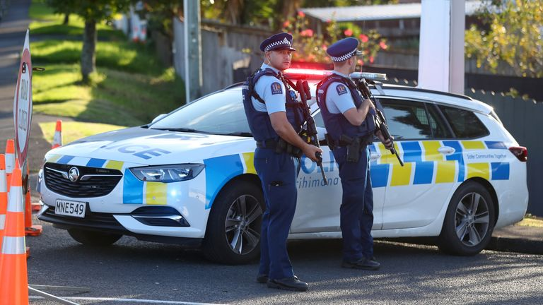 New Zealand Police are searching for the gunman, who fled the scene after shooting at the officers