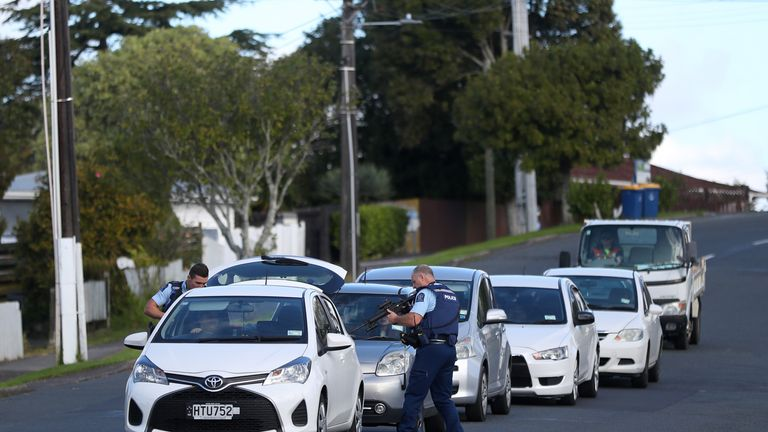 New Zealand Police check cars following the shooting