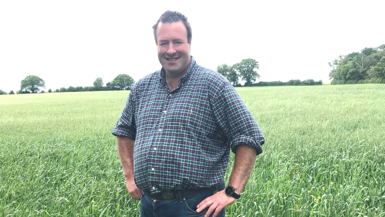 Stuart Roberts, deputy president NFU in a field of wheat at his Hertforfshire farm