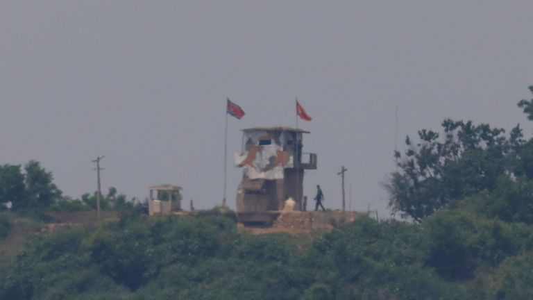 A North Korean soldier was seen beside his guard post near the demilitarised zone as the liaison building was blown up