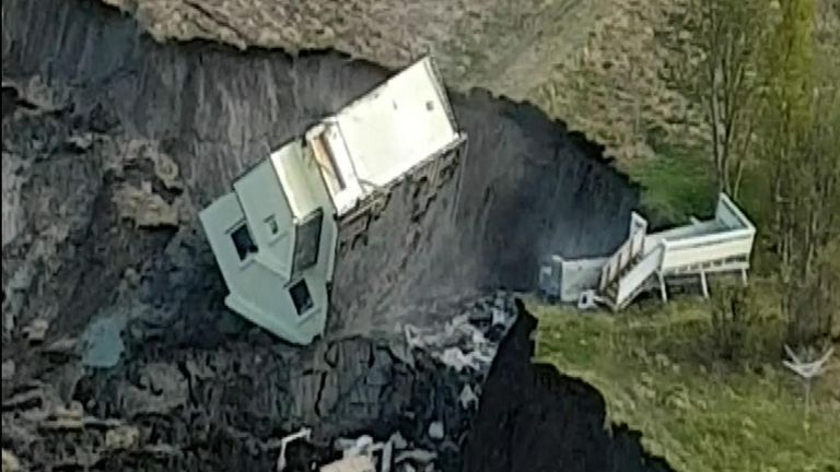 Eight buildings were swept away in several mudslides in Alta, northern Norway on Wednesday. A video from the Norwegian Armed Forces captures the moment one of the houses topples over. They also have pictures showing the Norwegian Elkhound Raja being rescued from the site of the slide in a helicopter by the No. 330 Squadron. The dog managed to swim ashore and is in good condition.