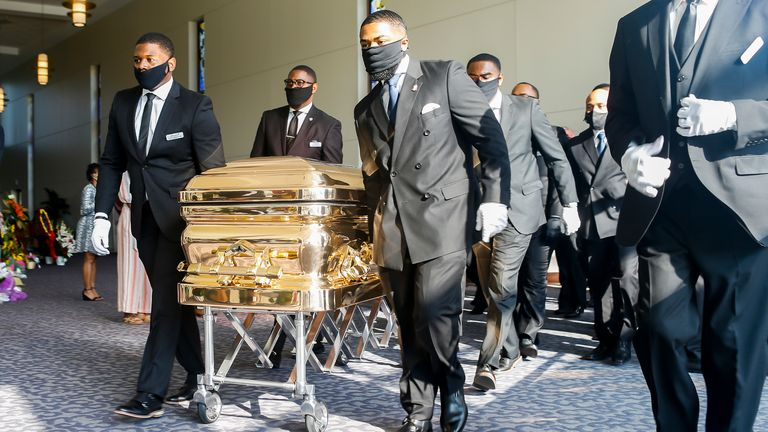Pall bearers carry George Floyd's coffin into the church for his funeral