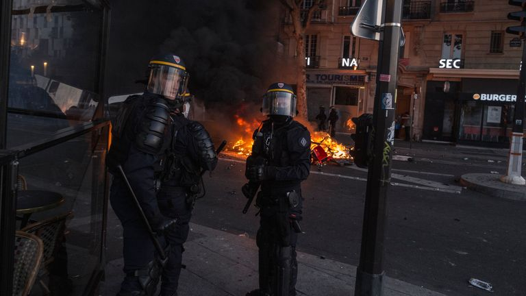 PARIS, FRANCE - JUNE 02: Police officers in riot gear stand nearby a pile of scooters that were set on fire during a protest against police brutality near the ...Tribunal de Paris... courthouse on June 2, 2020 in Paris, France. Thousands of people assembled to protest racism and police brutality despite a police order that the protest not proceed due to coronavirus restrictions. The protesters decried the 2016 death of Adama Traor.. while in police custody in the Paris suburbs, drawing comparisons to the recent killing of George Floyd in the US, whose death has sparked protests across that country. (Photo by Sam Tarling/Getty Images)