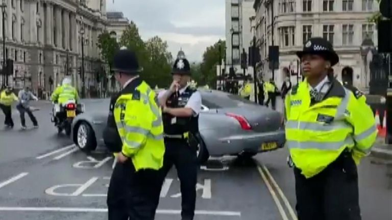 Prime Minister Boris Johnson's car was shunted by a security vehicle outside parliament when Kurdish protesters ran into the road