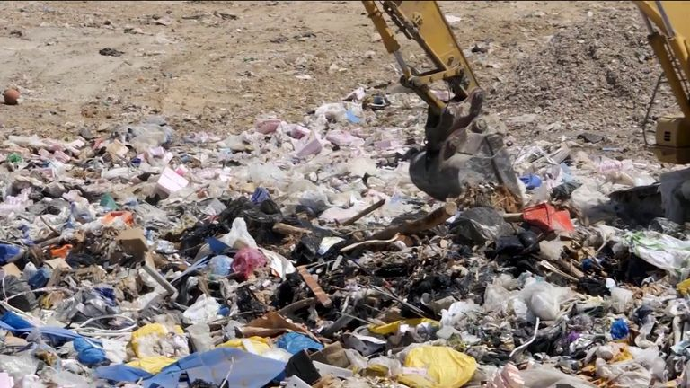 Tonnes of waste is dumped in a giant landfill site in Portugal.