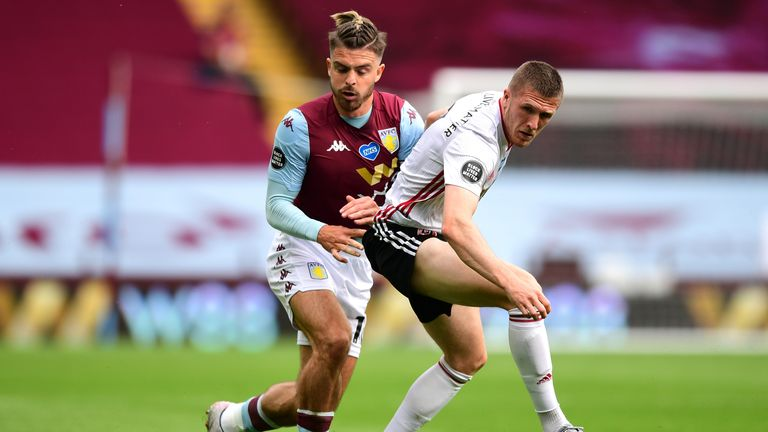 BIRMINGHAM, ENGLAND - JUNE 17: John Lundstram of Sheffield United is challenged by Jack Grealish of Aston Villa during the Premier League match between Aston Villa and Sheffield United at Villa Park on June 17, 2020 in Birmingham, England. (Photo by Shaun Botterill/Getty Images)